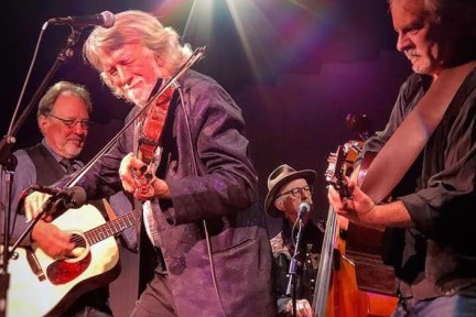 Photo of John McEuen and musicians